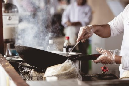 closeup-shot-chef-cooking-with-blurred-background_181624-30759